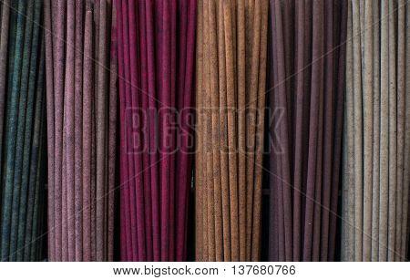 The multicolored incense sticks macro . .
