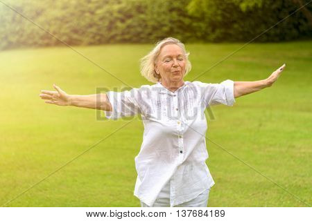 Calm Woman In White Clothing Exercising Outside