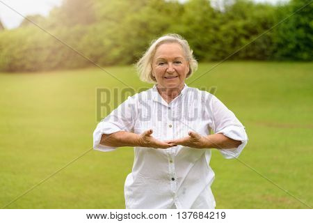 Smiling Woman Doing Breathing Exercises
