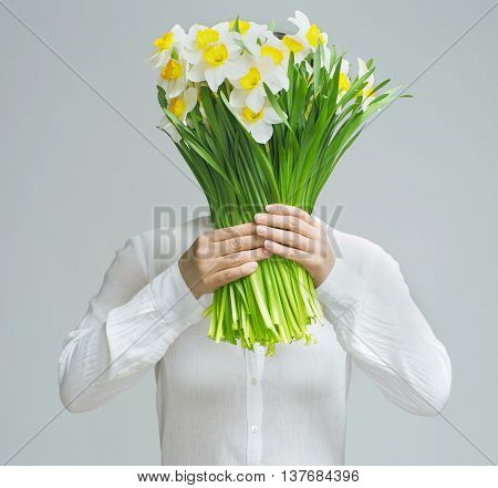 beautiful woman with yellow flowers on white backgraund