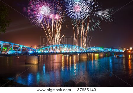 HUE, VIETNAM, April 30, 2016 fireworks, welcomed unification day. At Trang Tien Bridge, downtown Heu, evening