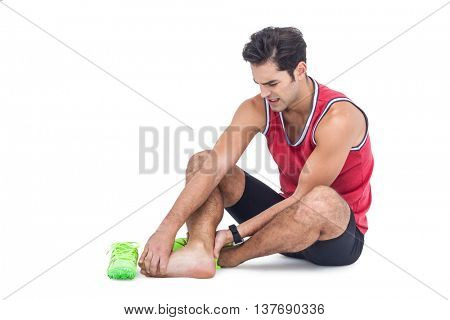 Male athlete with foot pain on isolated white background