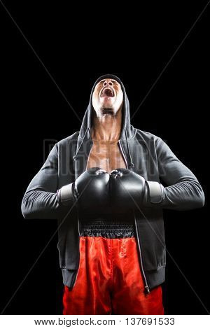 Boxer in black jacket preparing for the tournament