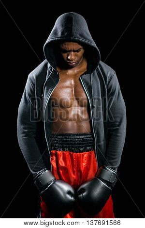 Depressed boxer posing after failure