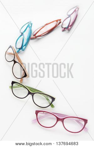 various colored spectacles isolated on white background