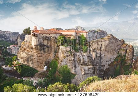 The Sacred Monastery of Varlaam, Meteora. Scenics  view of the Orthodox Varlaam Monastery, bridge  and a typical cable car in Meteora, Greece