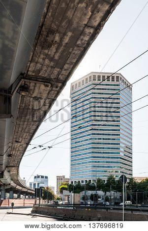Tall skyscraper in Genoa, called Matitone, as seen from underneath the Sopraelevata street