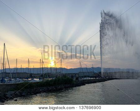 Sun Rays Over The Jet D'eaux In Geneva, Switzerland