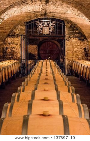 Winery Cellar In France With Barrels.