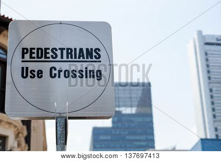 The sign of the pedestrians use for crossing