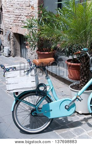 beautiful blue bicycle with wooden box italy