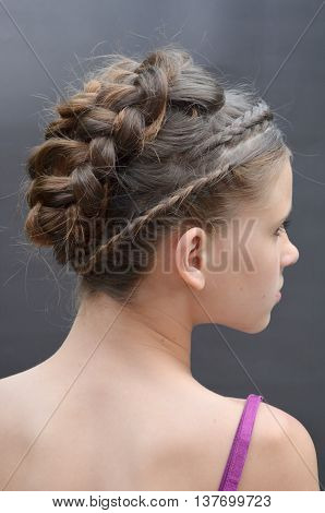 Hairstyle with long blond hair. French braid