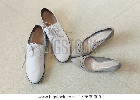 White shoes groom and beautiful bride's shoes