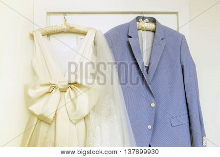 Wedding accessories - dress for the bride and groom's suit