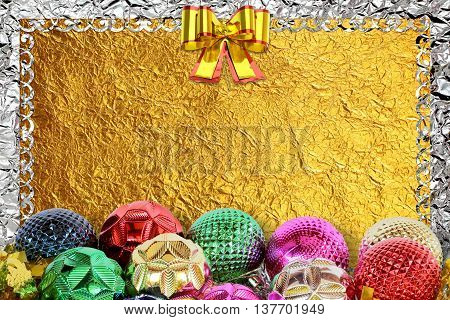 Christmas background with christmas ball and pattern on the gold foil background