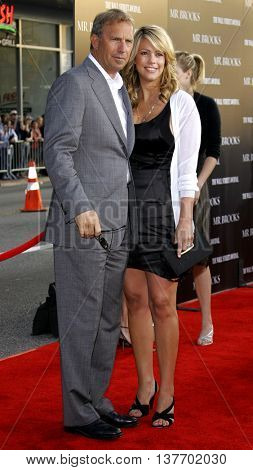 Kevin Costner and Christine Baumgartner at the Los Angeles premiere of 'Mr. Brooks' held at the Grauman's Chinese Theater in Hollywood, USA on May 22, 2007.
