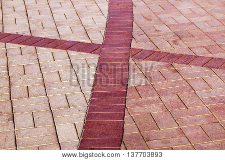 Brick Paved Promenade Background With Red Cross Shape
