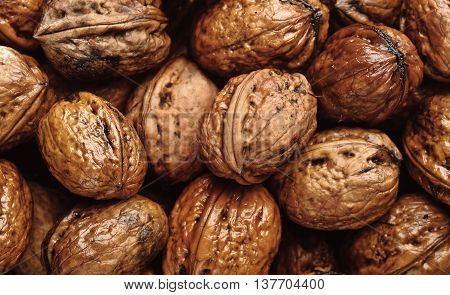 Photo Of Closeup Background Of Wet Walnuts