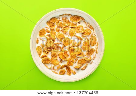 Bowl With Cornflakes On The Colorful Background