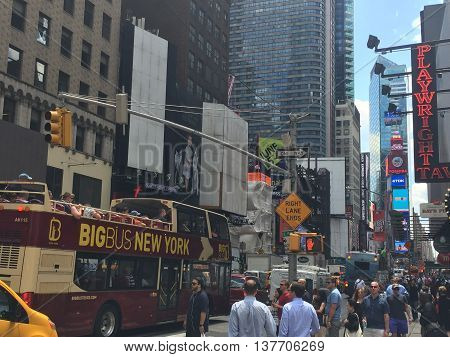 NEW YORK, NY - JUN 22: Times Square in Manhattan, featured with Broadway Theaters and animated LED signs, is a symbol of New York City and the United States, as seen on Jun 22, 2016.