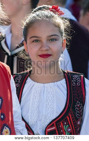 ROMANIA TIMISOARA - JULY 7 2016: Teenager from Romania in traditional costume present at the international folk festival