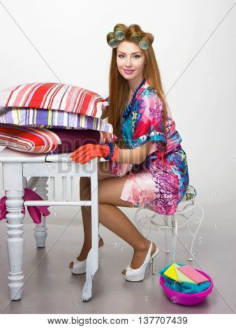Woman, A Housewife, Or A Small Business Owner And Entrepreneur At Robe Curlers On Her Heel, Doing La