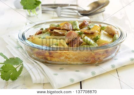 Casserole with potatoes chicken and green string bean