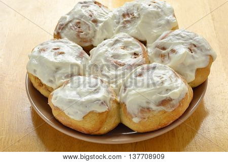 Fresh homemade cinnamon rolls on the plate, selective focus
