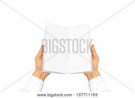 Hand in white shirt sleeve holding blank brochure booklet in the hand. Leaflet presentation. Pamphlet hand man. Man show paper. Sheet template. Menu in hands. Booklet design. Fold paper sheet display.