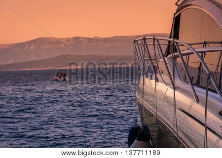 Luxury yacht in sunset time with Island of Hvar in background, Croatia, summertime.