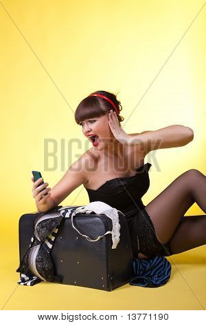 Young woman with broken baggage scream on cell