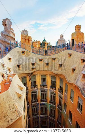 Roof With Chimneys And Tourists At Casa Mila Building