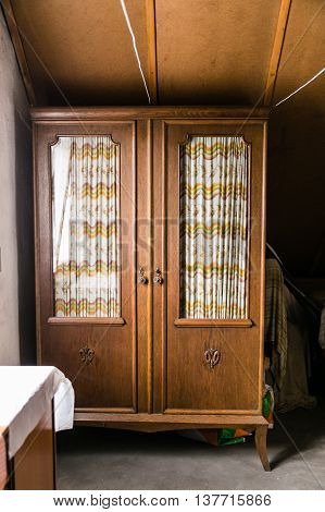 Antique old cupboard cabinet in a attic room