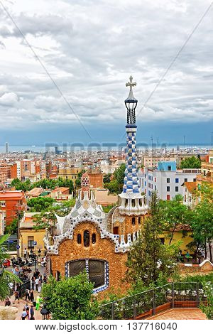 Tourists And Entrance Building In Park Guell In Barcelona