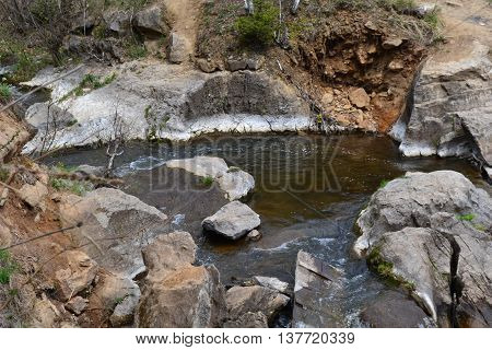 Small lake with a rocky shore in the highlands