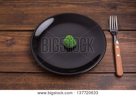 Broccoli With Black Plate, Fork On Wooden Rustic Background, Diet Concept With Broccoli. Top View