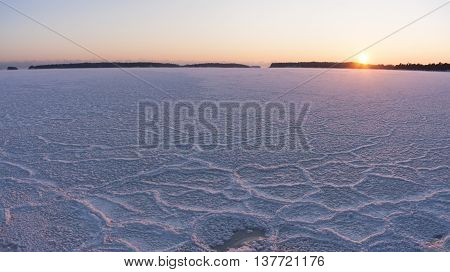 Landscape of winter sunset at frozen sea