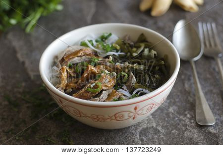 Shredded roast duck with cabbage and rice noodles