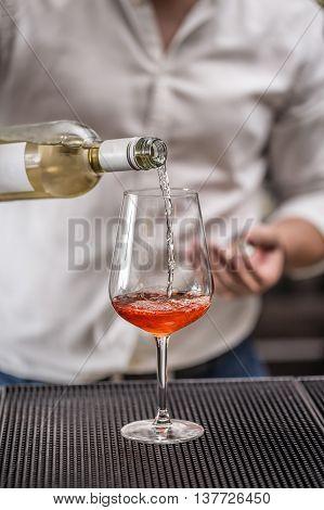 Barman at work preparing cocktails, drink concept