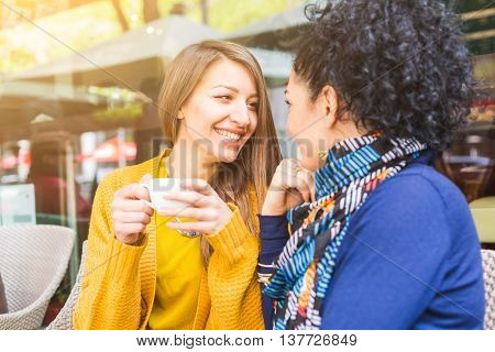 Lesbian Couple Having A Coffee At A Cafe