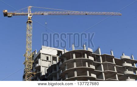 Unfinished living building with a crane jib