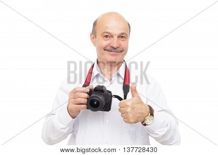 Elderly Man Is Holding A Camera And Shows Thumb Up