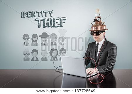 Idendity theft concept with vintage businessman and laptop at office