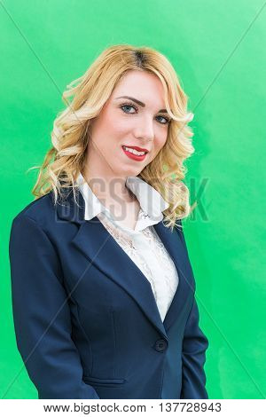 Portrait of Young woman in suits. Wearing blue suit she has blonde hair and blue eyes on a white background. Smile always smiling.
