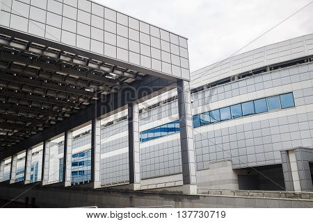 MINSK BELARUS - MAY 03 2016: Minsk-Arena - a sports and entertainment complex in the city of Minsk Belarus. Close-up of industrial buildings with a colonnade. Modern architecture.