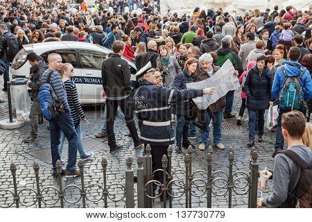 Policeman Helps Tourists Near Trevi Fountain