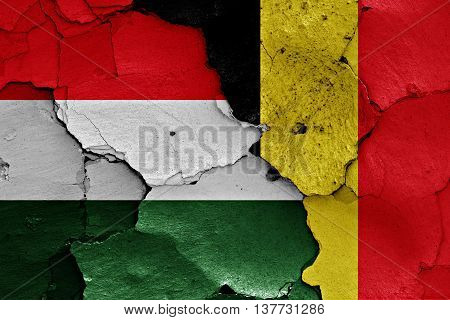 Flags Of Hungary And Belgium Painted On Cracked Wall