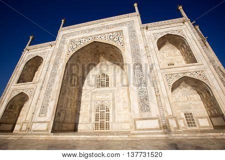 huge and beautiful Taj Mahal in sunrise light