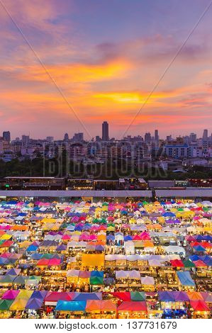 Arial view multiple colours night flea market roof top with beautiful sky background