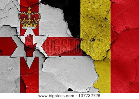 Flags Of Northern Ireland And Belgium Painted On Cracked Wall
